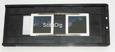 The slide mount holder FH-869M for mounted medium formats with two inserted 6x6 slides